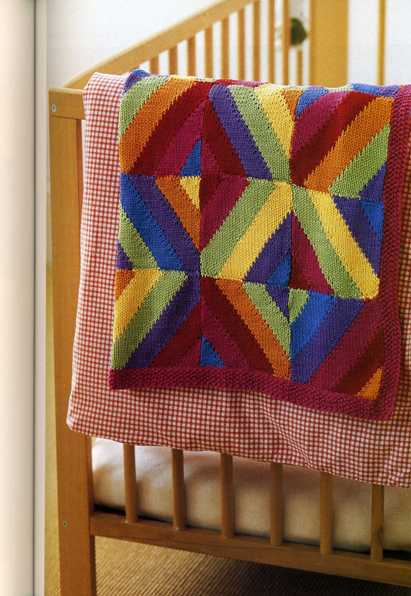 Узор этого вязаного покрывала напоминает затейливую игру кусочков...