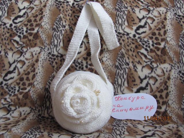 Фото Вязаная круглая сумка.
