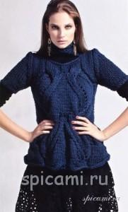 вязаный пуловер в косами