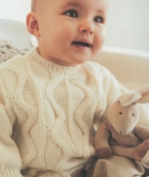 Пуловер с кисточками